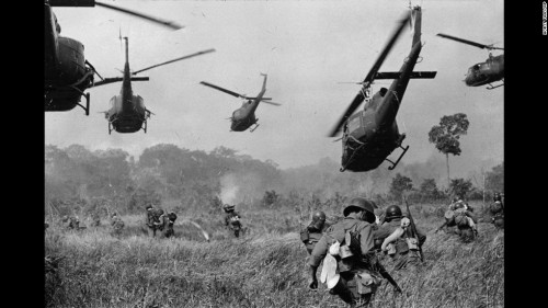 Hovering U.S. Army helicopters pour machine gun fire into the tree line to cover the advance of South Vietnamese ground troops in an attack on a Viet Cong camp 18 miles north of Tay Ninh, northwest of Saigon near the Cambodian border, in March 1965 during the Vietnam War.  (AP Photo/Horst Faas)